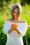 Girl holding fruit outdoor Royalty Free Stock Photo