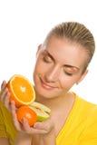 Girl holding fruits Stock Image