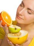 Girl holding fruits Royalty Free Stock Photo
