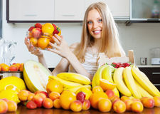 Girl holding  fruits in home Stock Photos