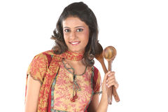 Girl holding frying stick Stock Images