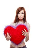 Girl holding fur red heart Stock Photos