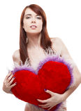 Girl holding fur red heart Stock Images