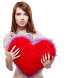 Girl holding fur red heart Royalty Free Stock Photos