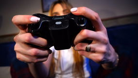 Girl holding a game joystick and clicks on buttons stock video footage