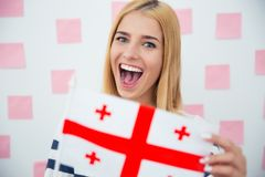 Girl holding Georgia flag Royalty Free Stock Images