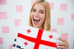 Girl holding Georgia flag Royalty Free Stock Images