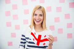 Girl holding Georgia flag Royalty Free Stock Photos