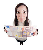 Girl holding giant euro note Royalty Free Stock Photography
