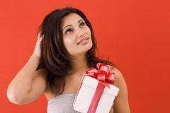 Girl holding a gift Stock Photography