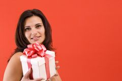Girl holding a gift Stock Photos