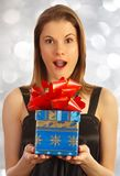 Girl holding a gift Royalty Free Stock Images