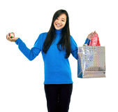 Girl Holding A Gift Bag. Girl standing holding a small gift box and a gift bag Royalty Free Stock Images