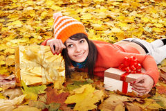 Girl  holding gift box. Stock Photos