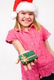 Girl holding a gift box Stock Images