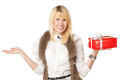 Girl holding gift box and copy space on open palm Stock Image