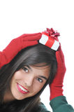 Girl Holding a Gift Box on Her Head stock photo