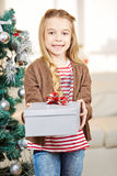 Girl holding gift at christmas eve Royalty Free Stock Photo