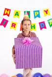 Girl holding a gift in hand for my birthday on a white background Royalty Free Stock Photography