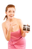 Girl holding a gift and smiling Royalty Free Stock Image