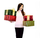 Girl Holding Gifts. Girl standing holding presents on a white background Royalty Free Stock Photo