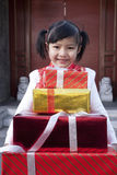 Girl Holding Gifts Royalty Free Stock Images