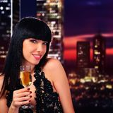Girl holding a glass of champagne Stock Photo
