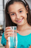 Girl holding a glass of fresh water Royalty Free Stock Photos