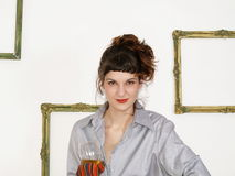 Girl holding a glass Royalty Free Stock Photography