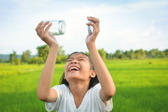 Girl holding glass jar for keeping fresh air Royalty Free Stock Images
