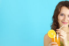 Girl holding a glass of juice Royalty Free Stock Photos