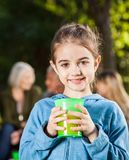 Girl Holding Glass Of Juice At Campsite Royalty Free Stock Photos