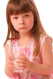 Girl holding glass of milk Royalty Free Stock Photos