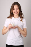 Girl holding glass of milk. Close up. White background Stock Photo
