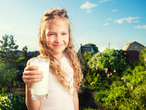 Girl holding glass with milk Stock Image