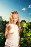 Girl holding glass with milk Royalty Free Stock Photography