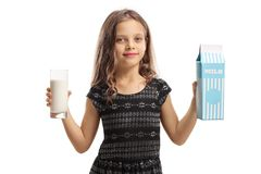 Girl holding a glass of milk and a milk carton. Isolated on white background Royalty Free Stock Images