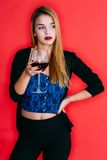 Girl holding a glass of red wine Royalty Free Stock Photo