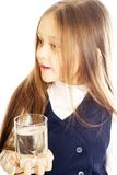 Girl holding a glass of water Royalty Free Stock Photography
