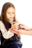 Girl  holding a glass of water. Little girl with long hair holding a glass of water Royalty Free Stock Photo