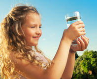 Girl holding glass with water Royalty Free Stock Photos