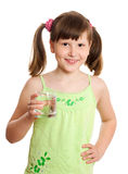 Girl holding glass of water Stock Photos