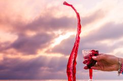 Girl holding a glass with wine during the sunset. On the sea. Photo taken in the summer season in Odesa city royalty free stock photo