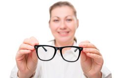 Girl holding glasses, glasses in focus Royalty Free Stock Photo
