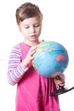 Girl holding globe Stock Photos