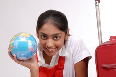 Girl holding a globe ready to travel Stock Photo