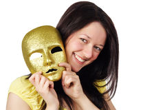 Girl holding a gold mask Royalty Free Stock Photography