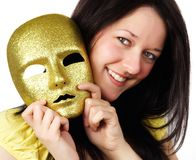 Girl holding a gold mask Stock Images