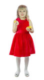 Girl holding a golden egg Royalty Free Stock Photos