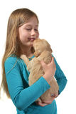 Girl holding a golden retriever pup Royalty Free Stock Photos